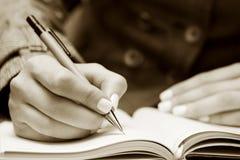 Businesswoman writing. Royalty Free Stock Photos