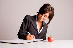Businesswoman writing. In a notebook Stock Photography