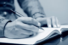 Businesswoman writing. Royalty Free Stock Images