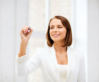 Businesswoman writing in the air Royalty Free Stock Images
