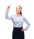 Businesswoman writing in the air with marker Royalty Free Stock Photography
