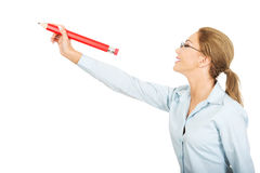 Businesswoman writing with big pencil. Royalty Free Stock Photography