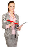Businesswoman writing with big pencil. Stock Image
