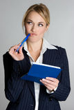 Businesswoman Writing Check. Beautiful blond businesswoman writing check Stock Photos