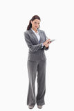 Businesswoman writing on a clipboard Stock Photography