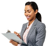 Businesswoman Writing On Clipboard Stock Photos