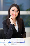 Businesswoman writing on a clipboard Stock Images