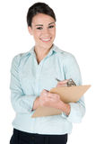 Businesswoman writing on clipboard, isolated Royalty Free Stock Photos