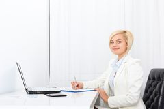 Businesswoman writing contract, signing document Royalty Free Stock Image