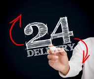Businesswoman writing 24 delivery Royalty Free Stock Photos