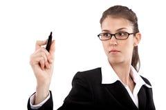 Businesswoman Writing on Diagram Stock Photo