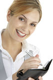 Businesswoman Writing In Diary Stock Photo