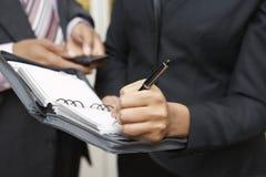 Businesswoman Writing In Diary Stock Photos