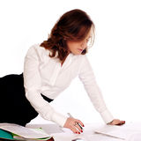 Businesswoman writing documents. Isolated on white Royalty Free Stock Photos