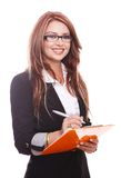 Businesswoman writing documents Royalty Free Stock Photography