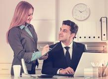 Businesswoman writing down tasks Royalty Free Stock Photo