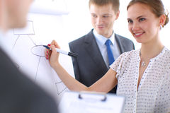 Businesswoman writing on flipchart while giving Royalty Free Stock Images