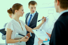 Businesswoman writing on flipchart while giving Royalty Free Stock Photo