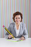 Businesswoman writing with a giant pencil Stock Photos