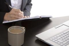 Businesswoman writing in her agenda Stock Image