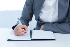 Businesswoman writing in her diary Stock Photography