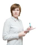 Businesswoman  writing on her notepad Stock Photography