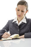 Businesswoman writing in her notepad Royalty Free Stock Images