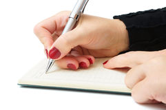 Businesswoman writing in her notepad Royalty Free Stock Photo