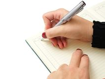 Businesswoman writing in her notepad Royalty Free Stock Photos