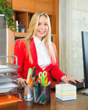 Businesswoman writing on her workplace Stock Photo
