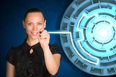 Businesswoman writing on holographic screen Stock Image