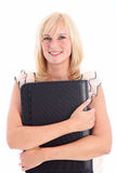 Businesswoman writing in large leather folder Royalty Free Stock Photography