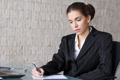 Businesswoman writing letter Royalty Free Stock Images