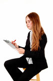 Businesswoman writing. Stock Images