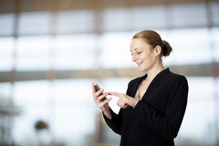 Businesswoman writing message on mobile phone Royalty Free Stock Photography