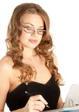 Businesswoman writing a note Stock Photo