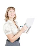 Businesswoman writing on a notebook Stock Images