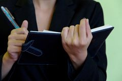 Businesswoman writing in notebook Royalty Free Stock Images