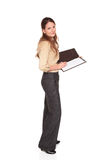 Businesswoman - writing on notepad. Isolated studio shot of a Caucasian businesswoman  looking down while writing on a business notepad Royalty Free Stock Photo