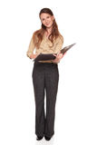 Businesswoman - writing on notepad. Isolated studio shot of a Caucasian businesswoman smiling at the camera while writing on a business notepad Royalty Free Stock Image