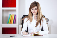 Businesswoman writing on the notepad Royalty Free Stock Photo