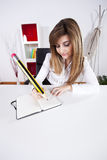 Businesswoman writing on the notepad Stock Image