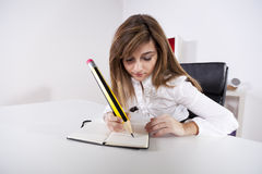 Businesswoman writing on the notepad Royalty Free Stock Images