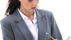 Businesswoman writing on a notepad Royalty Free Stock Image