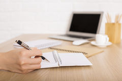 Businesswoman writing in notepad closeup Royalty Free Stock Photography