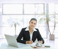 Businesswoman writing notes Royalty Free Stock Photos