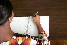 Businesswoman writing notes Stock Photos