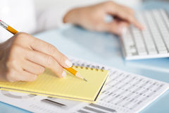 Businesswoman Writing Notes Royalty Free Stock Photo