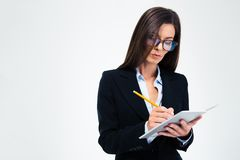 Businesswoman writing notes in notebook Royalty Free Stock Photos