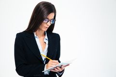 Businesswoman writing notes in notebook Stock Images